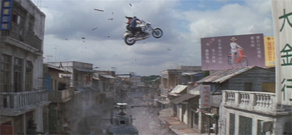 Bond and Wai Lin riding the motorcycle at high speeds through the streets of Saigon, through buildings, even up onto the roofs of the buildings