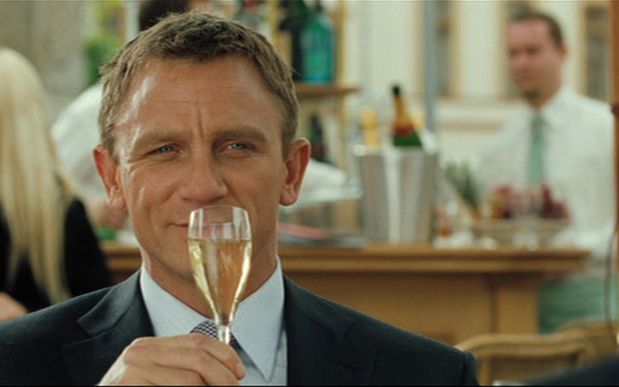 Daniel Craig  James Bond in Casino Royale Montenegro (Grand Hotel Pupp Karlovy Vary Tjeckien) with Champagne Bollinger glass flute with Bollinger logo on the glass.